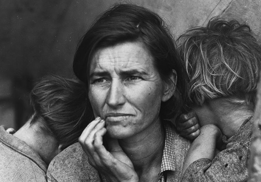 black and white photo of a woman and two children
